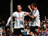 Ross McCormack of Fulham celebrates with team mate Sean Kavanagh after scoring his sides second goal from the penalty spot during the Sky Bet Championship match between Fulham and Middlesbrough at Craven Cottage on April 25, 2015