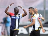 Emmanuel Agyemang Badu of Udinese Calcio celebrates with his teams mate Giampiero Pinzi after scoring his teams second goal during the Serie A match between Udinese Calcio and AC Milan at Stadio Friuli on April 25, 2015