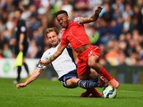 Craig Dawson of West Brom tackles Raheem Sterling of Liverpool during the Barclays Premier League match be
