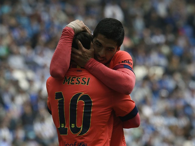 Barcelona's Argentinian forward Lionel Messi celebrates with Barcelona's Uruguayan forward Luis Suarez after scoring during the Spanish league football match RCD Espanyol v FC Barcelona at the Cornella-El Prat stadium in Cornella de Llobregat on April 25,