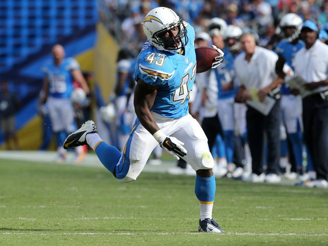 Running back Branden Oliver #43 of the San Diego Chargers carries the ball against the Kansas City Chiefs at Qualcomm Stadium on October 19, 2014