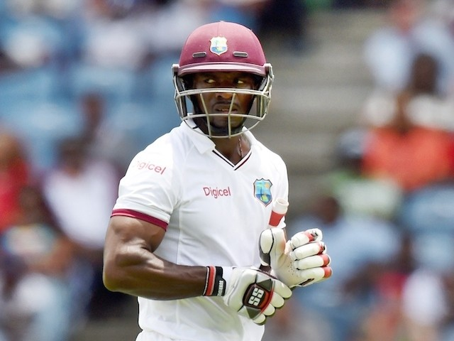 West Indies batsman Devon Smith leaves the field after being dimissed off England's bowler Chris Jordan during the second Test match between West Indies and England at the Grenada National Stadium in Saint George's on April 21, 2015