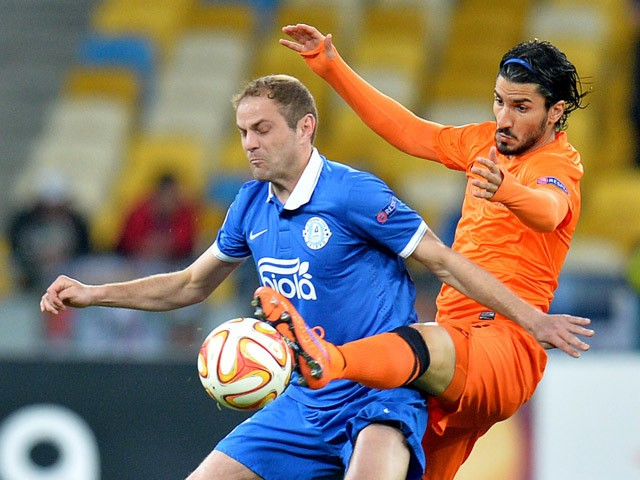 FC Dnipro's Yevhen Cheberyachko vies with Brugge's Lior Refaelov during the UEFA Europa League second leg quarter-final football match between FC Dnipro Dnipropetrovsk and Club Brugge KV in Kiev on April 23, 2015