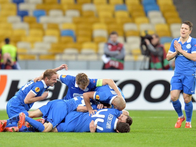 FC Dnipro's players celebrate after scoring a goal during the UEFA Europa League second leg quarter-final football match between FC Dnipro Dnipropetrovsk and Club Brugge KV in Kiev on April 23, 2015