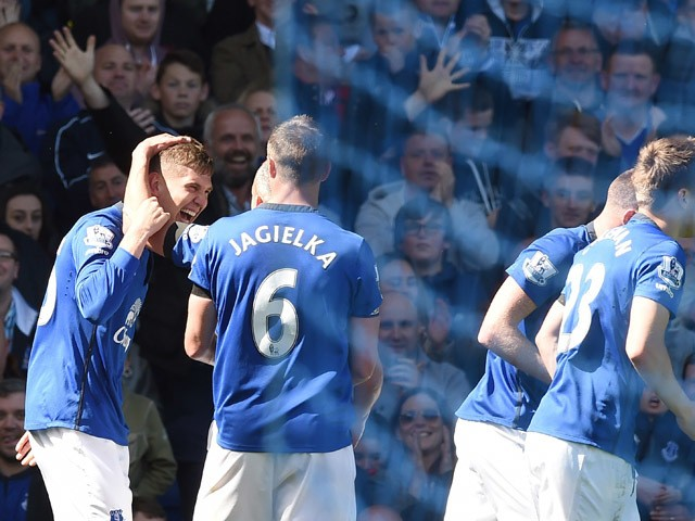 Everton's English defender John Stones celebrates with teammates after scoring their secong doal during the English Premier League football match between Everton and Manchester United at Goodison park in Liverpool on April 26, 2015