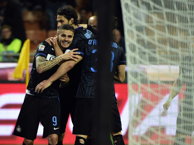 Inter Milan's forward from Argentina Mauro Icardi celebrates after scoring during the Italian Serie A football match Inter Milan vs Roma on April 25, 2015
