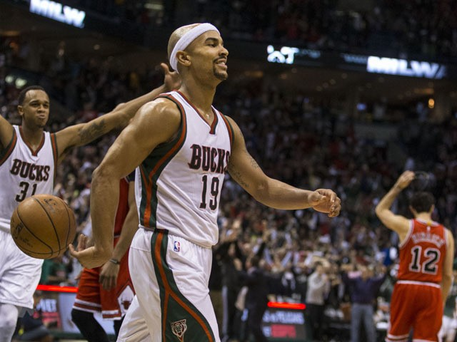 Guard Jerryd Bayless #19 of the Milwaukee Bucks is is all smiles after he hit the game winning shot against the Chicago Bulls in the fourth quarter of game four of the first round of the 2015 NBA Playoffs April 25, 2015