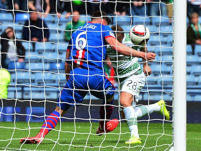 Josh Meekings of Inverness Caledonian Thistle apparently handles the ball on the goal line from Leigh Griffiths of Celtic during the William Hill Scottish Cup Semi Final match between Inverness Caledonian Thistle and Celtic at Hamden Park on April 19, 201