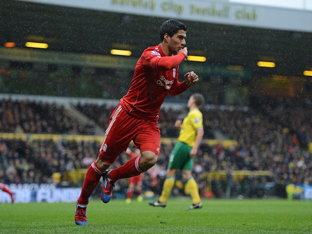Liverpool's Uruguayan striker Luis Suarez celebrates scoring his first goal during the English Premier League football match between Norwich City and Liverpool at Carrow Road stadium in Norwich, England on April 28, 2012