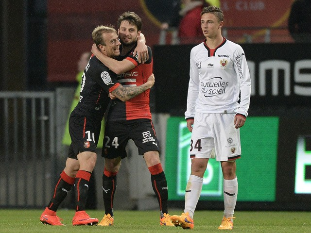 Rennes' Bosnian midfielder Sanjin Prcic celebrates with Rennes' Polish forward Kamil Grosicki after scoring a goal during the French L1 football match between Rennes and Nice on April 25, 2015