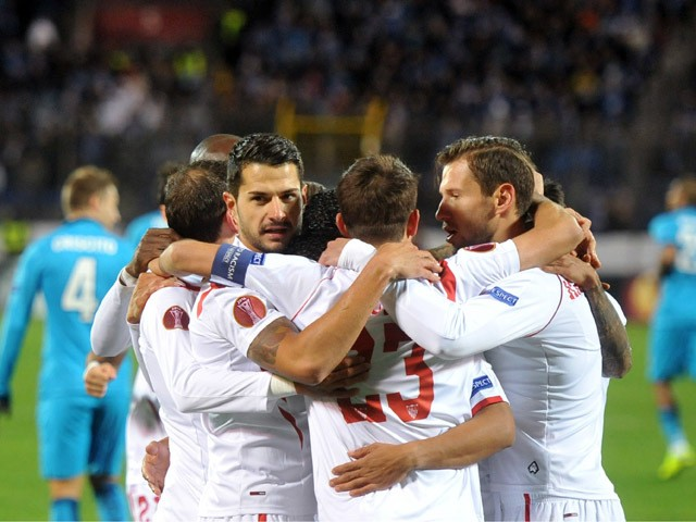 Sevilla's players celebrate after scoring a goal during the UEFA Europa League quarter-final second leg football match Zenit Saint Petersburg vs Sevilla FC at Petrovsky stadium in Saint Petersburg on April 23, 2015