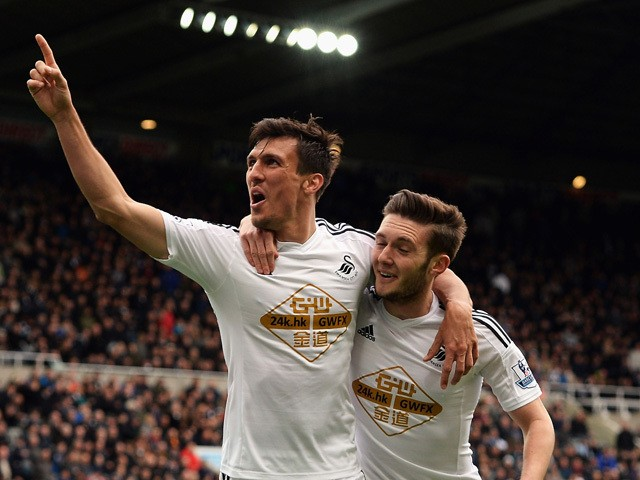 Jack Cork of Swansea City celebrates scoring their third goal with Matt Grimes of Swansea City during the Barclays Premier League match between Newcastle United and Swansea City at St James' Park on April 25, 2015