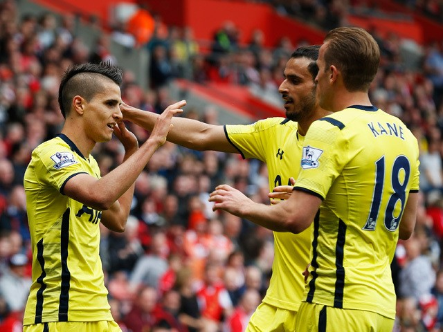 Erik Lamela of Spurs celebrates scoring their first goal with Nacer Chadli and Harry Kane of Spurs during the Barclays Premier League match between Southampton and Tottenham Hotspur at St Mary's Stadium on April 25, 2015