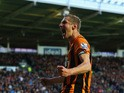 Michael Dawson of Hull City celebrates as he scores their first goal during the Barclays Premier League match between Hull City and Liverpool at KC Stadium on April 28, 2015