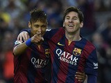Barcelona's Brazilian forward Neymar da Silva Santos Junior (L) and Barcelona's Argentinian forward Lionel Messi (R) celebrate after scoring a goal during the Spanish league football match FC Barcelona vs Getafe at the Camp Nou stadium in Barcelona