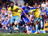 Willian of Chelsea battles with Joe Ledley and Jason Puncheon of Crystal Palace during the Barclays Premier League match between Chelsea and Crystal Palace at Stamford Bridge on May 3, 2015