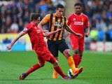 Jake Livermore of Hull City takes on Joe Allen and Jordon Ibe of Liverpool during the Barclays Premier League match between Hull City and Liverpool at KC Stadium on April 28, 2015