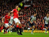 Robin van Persie of Manchester United reacts after taking a penalty which is saved by Boaz Myhill of West Brom during the Barclays Premier League match between Manchester United and West Bromwich Albion at Old Trafford on May 2, 2015