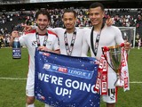 Will Grigg,Dele Alli and Lewis Baker of MK Dons celebrate after gaining promotion to the Championship at the end of the Sky Bet League One match between MK Dons and Yeovil Town at Stadium mk on May 3, 2015