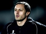Grimsby manager Paul Hurst looks on ahead of the Skrill Conference Premier League match between Barnet and Grimsby Town at The Hive Stadium on February 18, 2014