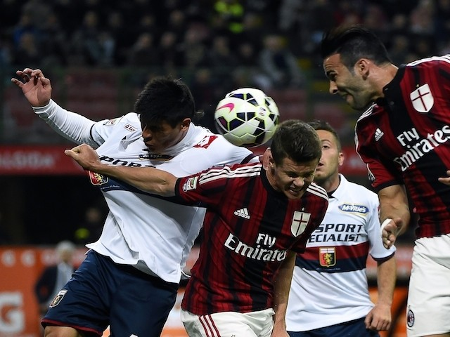 AC Milan's Adil Rami, Marco Van Ginkel (C) vie for the ball with Genoa's Argentinian defender Facundo Roncaglia during the Italian Serie A football match on April 29, 2015