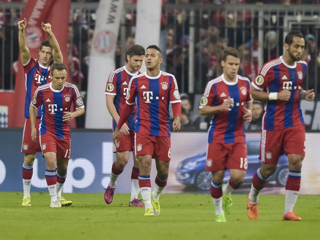Bayern Munich's Polish striker Robert Lewandowski celebrates scoring with his team-mates during the German Cup DFB Pokal semi-final football match FC Bayern Munich v Borussia Dortmund in Munich, southern Germany, on April 28, 2015