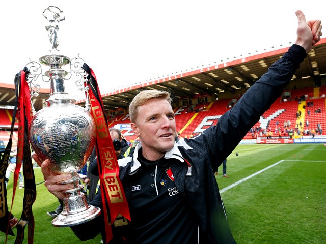 Eddie Howe, manager of Bournemouth celebrates with the trophy after winning the Championship during the Sky Bet Championship match between Charlton Athletic and AFC Bournemouth at The Valley on May 2, 2015