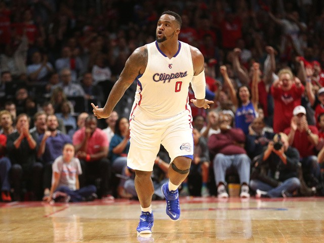 Glen Davis #0 of the Los Angeles Clippers celebrates after making a basket against the San Antonio Spurs during Game Five of the Western Conference quarterfinals of the 2015 NBA Playoffs at Staples Center on April 28, 2015