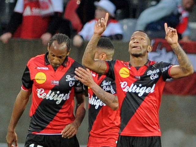 Guingamp's French midfielder Claudio Beauvue jubilates after scoring during the French L1 football match Guingamp versus Reims on May 2, 2015