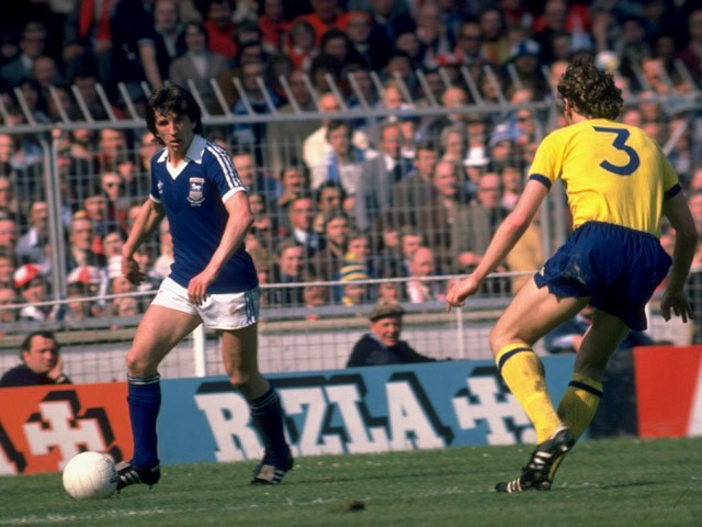 Paul Mariner of Ipswich Town is watched by Sammy Nelson of Arsenal during the FA Cup Final at Wembley in London on May 6, 1978