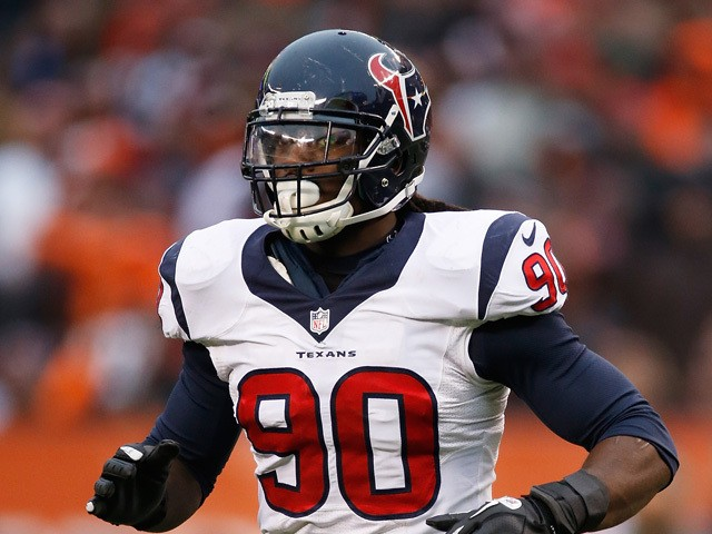 Jadeveon Clowney #90 of the Houston Texans runs onto the field during the fourth quarter against the Cleveland Browns at FirstEnergy Stadium on November 16, 2014