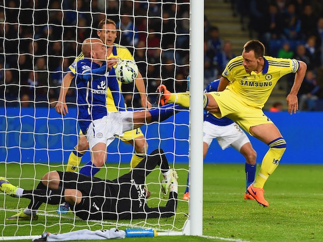 John Terry of Chelsea scores their second goal past Kasper Schmeichel of Leicester City during the Barclays Premier League match between Leicester City and Chelsea at The King Power Stadium on April 29, 2015