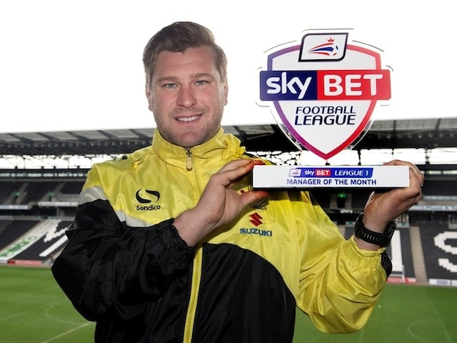 MK Dons manager Karl Robinson with his League One Manager of the Month award for April on April 30, 2015