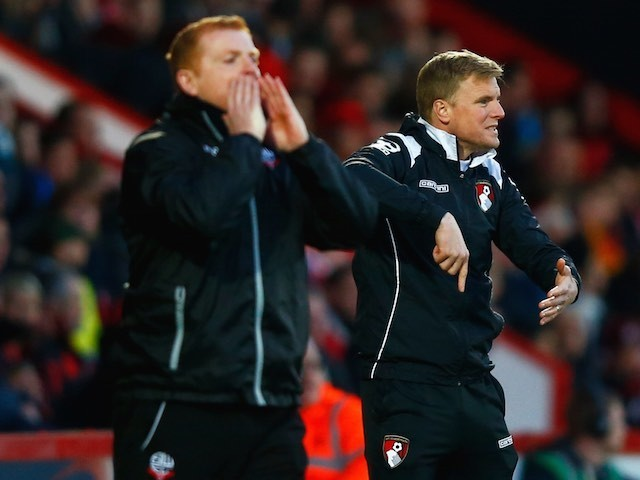 Bolton boss Neil Lennon and Bournemouth counterpart Eddie Howe on the touchline on April 27, 2015