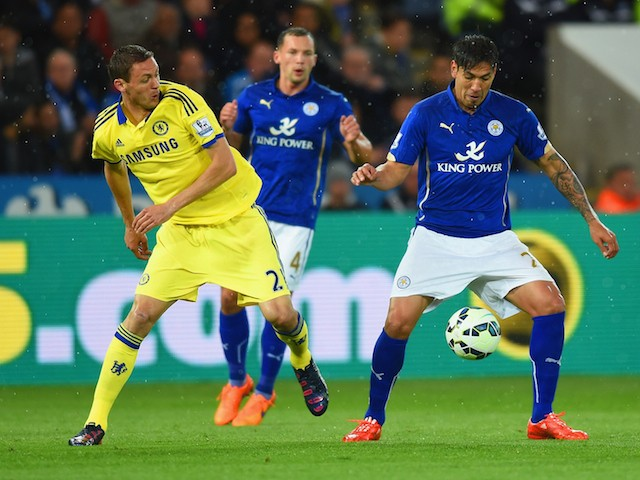 Nemanja Matic of Chelsea marshalls Leonardo Ulloa of Leicester City during the Barclays Premier League match between Leicester City and Chelsea at The King Power Stadium on April 29, 2015