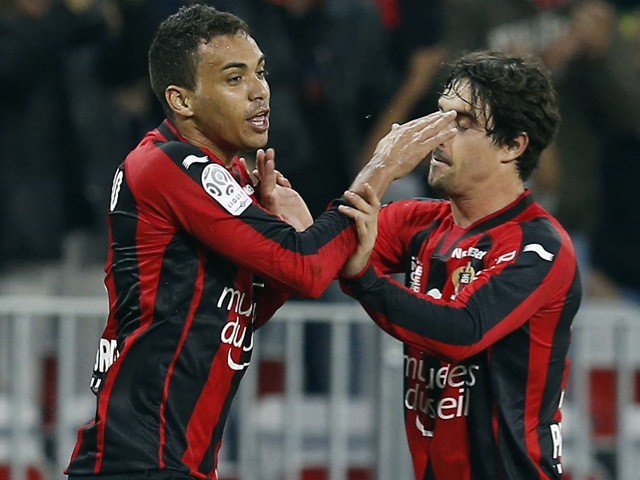 Nice's Brazilian midfielder Carlos Eduardo celebrates with Nice's French defender Gregoire Puel after scoring a goal during the French L1 football match between Nice and Caen on May 2, 2015