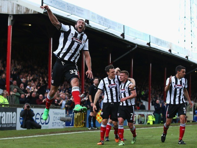 Ollie Palmer of Grimsby Town celebrates his second goal during the Vanarama Football Conference League match between Grimsby Town and Eastleigh FC at Blundell Park on May 3, 2015