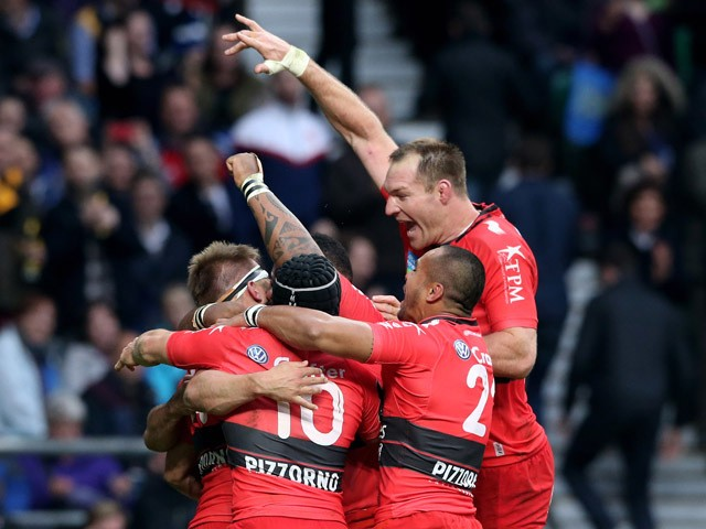 Drew Mitchell of Toulon is congratulated by teammates after scoring his team's second try during the European Rugby Champions Cup Final match between ASM Clermont Auvergne and RC Toulon at Twickenham Stadium on May 2, 2015