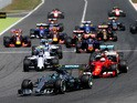 Nico Rosberg of Germany and Mercedes GP leads Sebastian Vettel of Germany and Ferrari and Lewis Hamilton of Great Britain and Mercedes GP into the first corner during the Spanish Formula One Grand Prix at Circuit de Catalunya on May 10, 2015