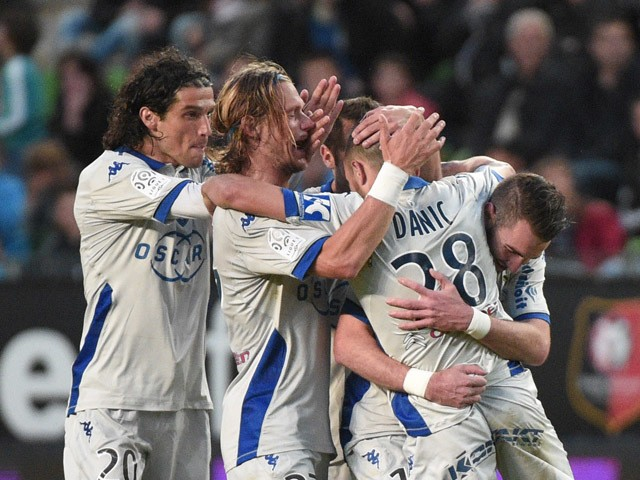 Bastia's French striker Gael Danic (jersey #28) celebrates with teammates after scoring during the French L1 football match Rennes against Bastia on May 9, 2015