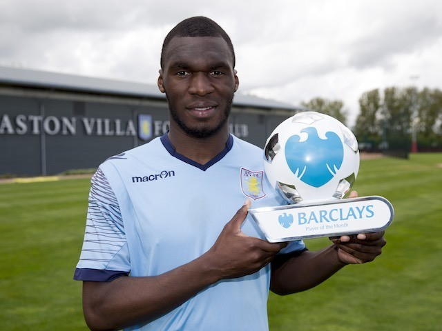 Christian Benteke poses with his player of the month award for April 2015