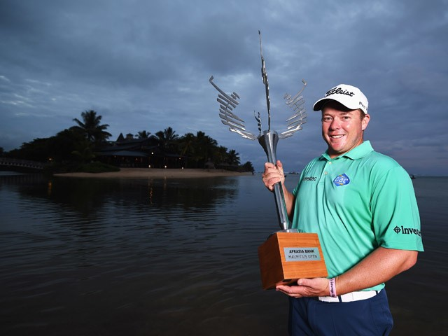 George Coetzee of South Africa with the trophy after winning the AfrAsia Bank Mauritius Open at Heritage Golf Club on May 10, 2015