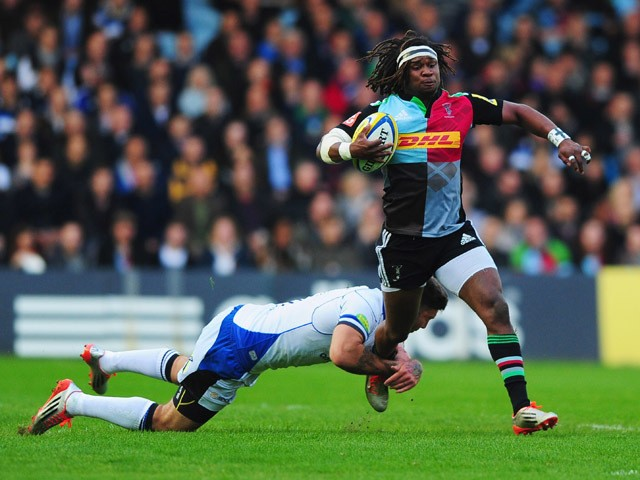 Marland Yarde of Harlequins is tackled by Matt Banahan of Bath Rugby during the Aviva Premiership match between Harlequins and Bath Rugby at Twickenham Stoop on May 8, 2015