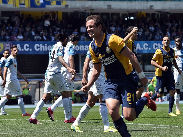 Juan Ignazio Gonez # 21 of Hellas Verona FC celebrates after scoring his team's first goal during the Serie A match between AC Chievo Verona and Hellas Verona FC at Stadio Marc'Antonio Bentegodi on May 10, 2015