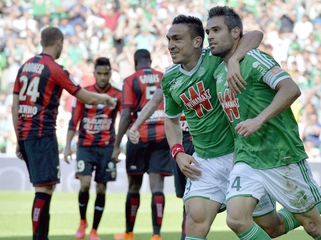 Saint-Etienne's French forward Melvut Erding (2nd R) and Saint-Etienne French defender Loic Perrin (R) celebrate after scoring a goal during the French L1 football match between Saint-Etienne and Nice on May 10, 2015