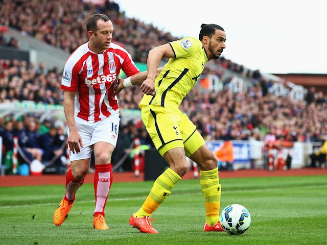 Nacer Chadli of Tottenham Hotspur is closed down by Charlie Adam of Stoke City during the Barclays Premier League match between Stoke City and Tottenham Hotspur at Britannia Stadium on May 9, 2015