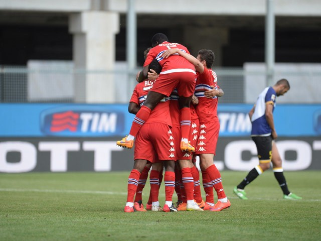 Roberto Soriano of UC Sampdoria is mobbed by team mates after scoring his team's second goal during the Serie A match between Udinese Calcio and UC Sampdoria at Stadio Friuli on May 10, 2015