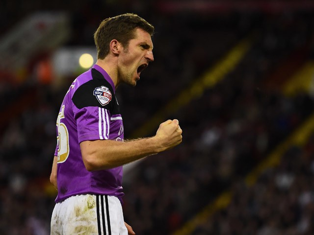 Sam Ricketts of Swindon Town celebrates after scoring the equalising goal during the Sky Bet Championship semi final match first leg match between Sheffield United and Swindon Town at Bramall Lane on May 7, 2015