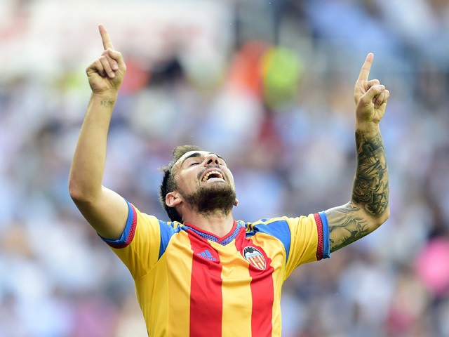 Valencia's forward Paco Alcacer celebrates after scoring during the Spanish league football match Real Madrid CF vs Valencia CF at the Santiago Bernabeu stadium in Madrid on May 9, 2015