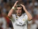 Real Madrid's Welsh forward Gareth Bale gestures during the UEFA Champions League semifinal second leg football match Real Madrid FC vs Juventus at the Santiago Bernabeu stadium in Madrid on May 13, 2015
